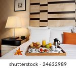 Stock photo tray with breakfast on a bed in a hotel room 24632989