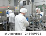 Three Workers In Uniforms At...