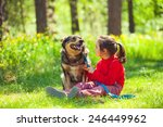 Little Girl Sitting With Dog O...