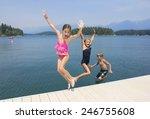 Kids Playing At The Lake On...