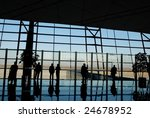 travelers silhouettes at airport | Shutterstock . vector #24678952
