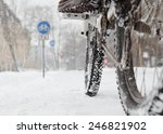 Riding A Bicycle In Winter Ove...