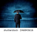 Business Man Standing In Rain...