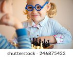 two cute children playing chess ... | Shutterstock . vector #246875422