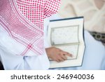 young arabic muslim man reading ... | Shutterstock . vector #246940036