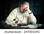 Man working on household finances - stock photo