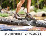 Hiking Man Crossing River In...