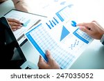 business people discussing the... | Shutterstock . vector #247035052