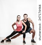 Athletic Man And Woman Doing...