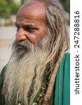 homeless man with beard  | Shutterstock . vector #247288816