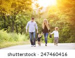 happy young family walking down ... | Shutterstock . vector #247460416