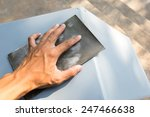 hand with a black sandpaper | Shutterstock . vector #247466638