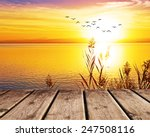 pier on the lake at sunset | Shutterstock . vector #247508116
