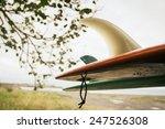Vintage Surfboard Hanging On...