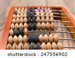 old wooden abacus on wood... | Shutterstock . vector #247556902