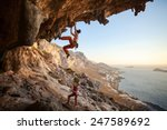 young woman lead climbing in... | Shutterstock . vector #247589692