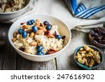oatmeal with berries and nuts | Shutterstock . vector #247616902