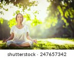 young girl meditating in the... | Shutterstock . vector #247657342