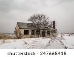 Abandoned Yellow House In Snow.