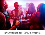 Stock photo ecstatic friends with champagne talking at party in night club 247679848