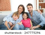 cheerful family at home sitting ... | Shutterstock . vector #247775296