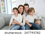 cheerful family at home sitting ... | Shutterstock . vector #247793782