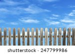 Old Wooden Fence On A Blue Sky...