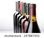 Wine Bottles In Row Isolated O...