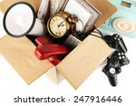 box of unwanted stuff close up   Shutterstock . vector #247916446