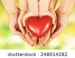 red heart in family hands on... | Shutterstock . vector #248014282