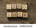 good luck text on a wooden cubes | Shutterstock . vector #248022442