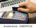 hand swiping credit card in...   Shutterstock . vector #248059126