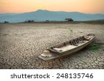 the wood boat on cracked earth  ... | Shutterstock . vector #248135746