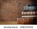 old book on wooden background. | Shutterstock . vector #248154502