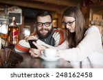 friends in a cafe using phone... | Shutterstock . vector #248162458