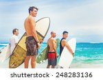 Group Of Surfers On A Beach