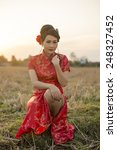 chinese woman red dress... | Shutterstock . vector #248327452