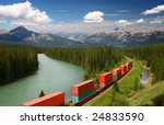 Freight train moving along Bow river in Canadian Rockies, Banff National Park, Alberta, Canada