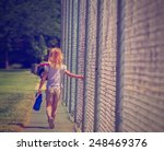 Young Girl Walking Dragging...