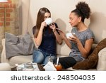 friends in coffee shop. two... | Shutterstock . vector #248504035