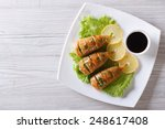 Grilled Squid On A Plate With...