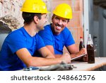 builders having break on... | Shutterstock . vector #248662576