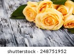 Beautiful Roses On Wooden Dark...