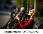 Girl With Saxophone On Street