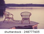 two chairs on dock with glasses ... | Shutterstock . vector #248777605