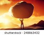Man Lifting A Huge Rock....