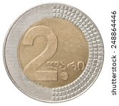 Small photo of two Georgian lari coin isolated on white background