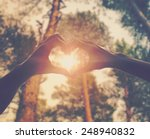 Stock photo hands in shape of love heart 248940832