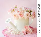 roses in a decorative watering... | Shutterstock . vector #248966842