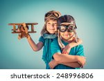 happy kids playing with vintage ... | Shutterstock . vector #248996806